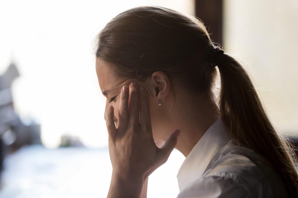 A woman with a hormonal migraine