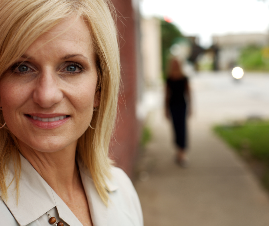 A blonde female physician offering hormone replacement therapy